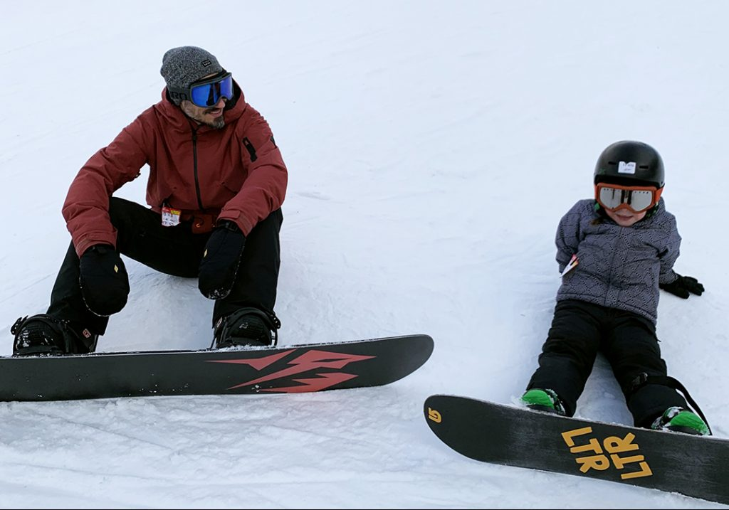 Marco Di Vittorio with his daughter snowboarding