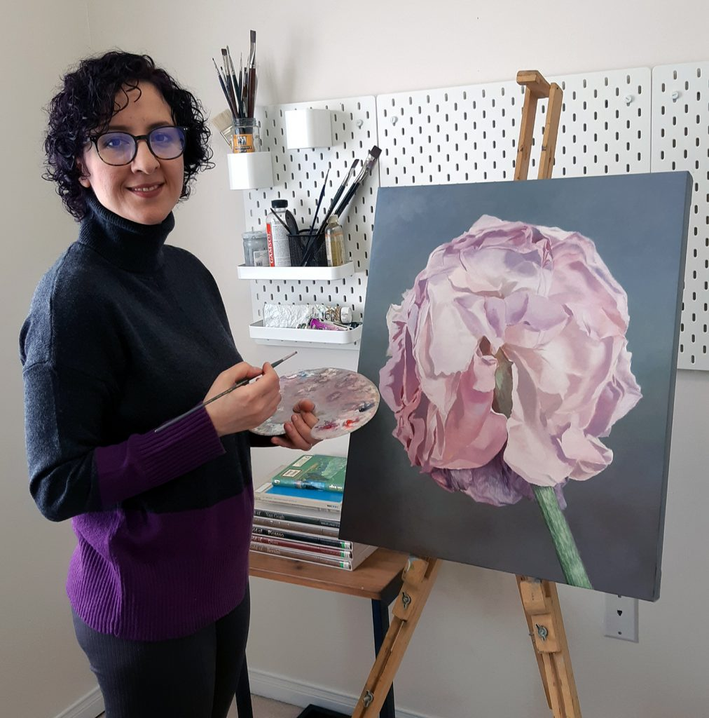 Maryam Shafiei pictured with her art work: a painting of a pink flower