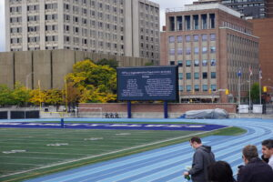The varsity stadium jumbo-tron displaying the names of UCheck implementation team members